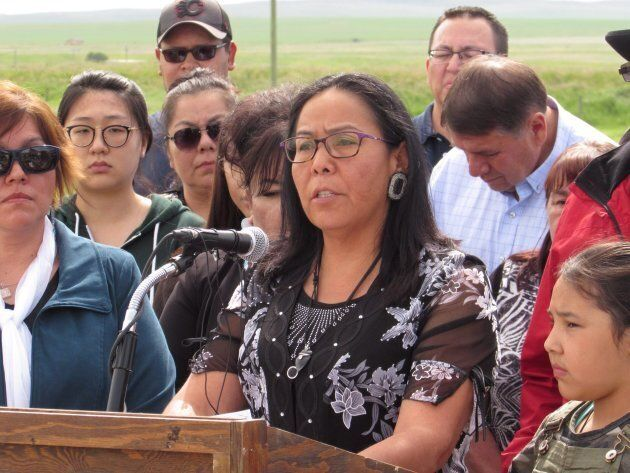 Ramona Big Head, a principal on the Blood Tribe in southern Alberta speaks to reporters in Standoff,...