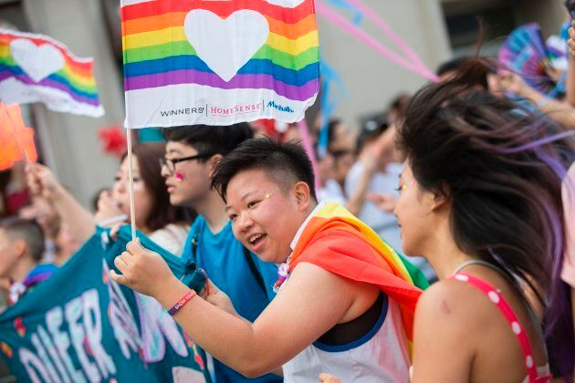 A woman waves a pride flag as she marches in the Pride Parade in Toronto, Ontario, June 25, 2017.