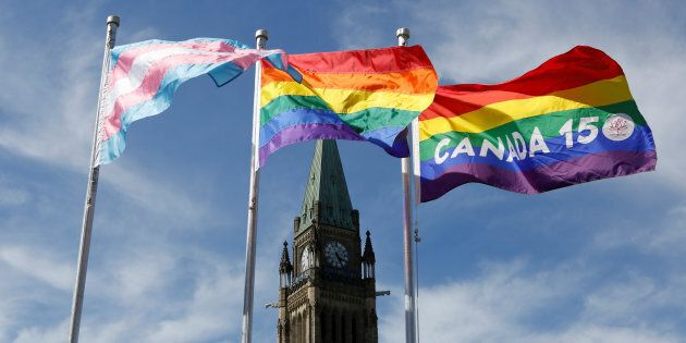 The transgender pride, pride and Canada 150 pride flags fly following a flag raising ceremony on Parliament Hill in Ottawa, Ontario, Canada on June 14, 2017.