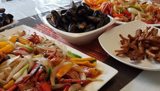 My partner's mom whipped up this Szechuan-style lobster, mussels and chicken feet. In The Philippines,...