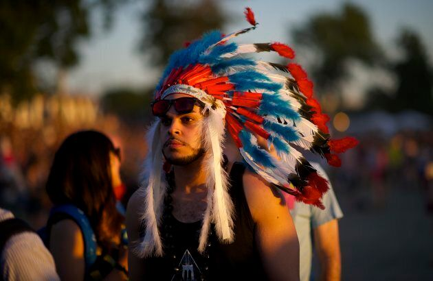 A festival-goer wears a Native American headdress during the Governors Ball Music Festival on Randall's Island in New York, NY on June 7, 2014.