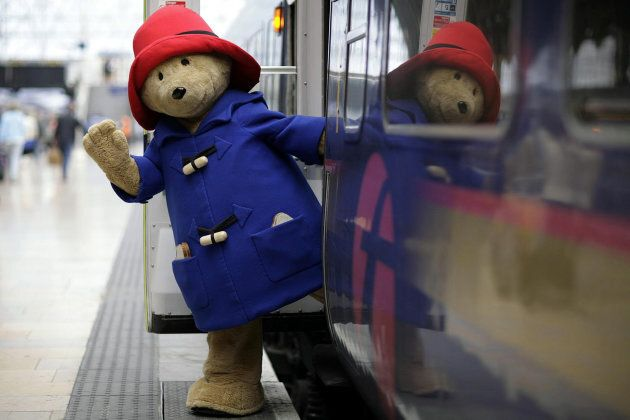Paddington Bear arrives at Paddington Station, London, on his way to the Children's Summer Party at Buckingham