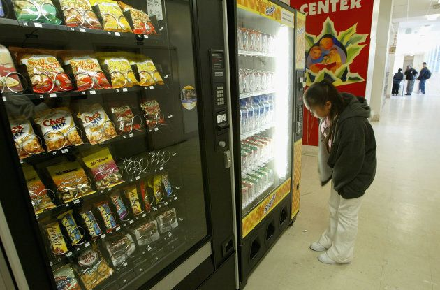 A student buys snacks from a vending machine at Mission High School April 8, 2004 in San Francisco, California.