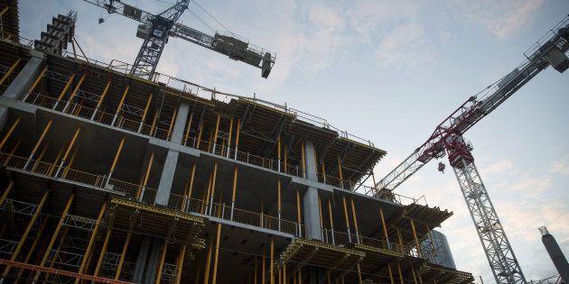 Cranes operate at a condominium under construction in Toronto, Ontario, Canada, on Saturday, May 27,...