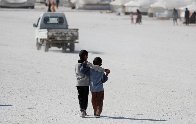 Two boys walk at a camp for people displaced from fighting in the Islamic State stronghold of Raqqa, in Ain Issa, Syria June 14, 2017.