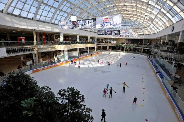 People skate at the Ice Palace skating rink at the West Edmonton Mall.