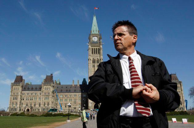 Ottawa professor Hassan Diab leaves the Parliament Hill following a news conference in Ottawa April 13, 2012.