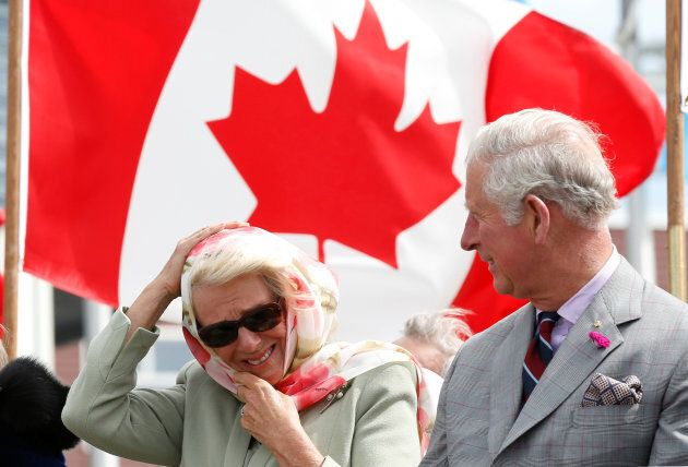Britain's and Camilla, Duchess of Cornwall, reacts to the wind while sitting next to Prince Charles during an official welcome ceremony at the Nunavut Legislative Assembly in Iqaluit, Nunavut, Canada, June 29, 2017. REUTERS/Chris Wattie