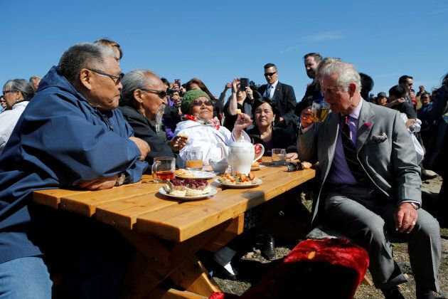 Britain's Prince Charles drinks tea during a tour of Sylvia Grinnell Park in Iqaluit, Nunavut, Canada, June 29, 2017. REUTERS/Chris Wattie