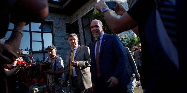 NDP leader John Horgan arrives to speak with Lt.-Gov. Judith Guichon at the Government House in Victoria,...