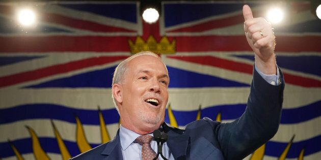 British Columbia NDP Leader John Horgan gives the thumbs up to the crowd at his election night speech...