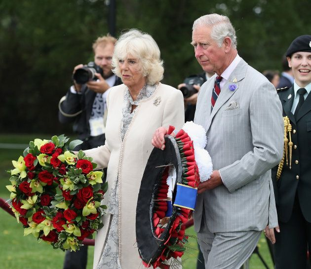 Camilla, Duchess of Cornwall and Prince Charles, Prince of Wales lay a wreath at the Afghanistan Repatriation Memorial at CFB Trenton on June 30.  (Photo by Chris Jackson/Getty Images)