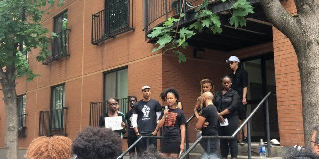Demonstrators hold a protest outside the apartment where Pierre Coriolan was shot dead by police in