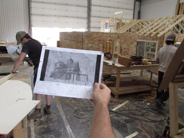 Tyson Leavitt is seen inspecting a concept illustration for a playhouse inside his workshop in Lethbridge,...