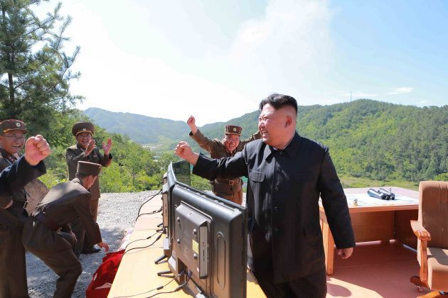 North Korean Leader Kim Jong Un reacts during the test-fire of intercontinental ballistic missile Hwasong-14...