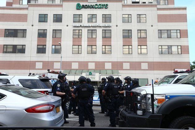 Police officers take security measures outside the Bronx-Lebanon Hospital after a shooter opened fire,...