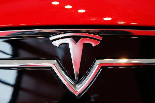 A Tesla logo on a Model S is photographed inside of a Tesla dealership in New York, U.S., April 29,
