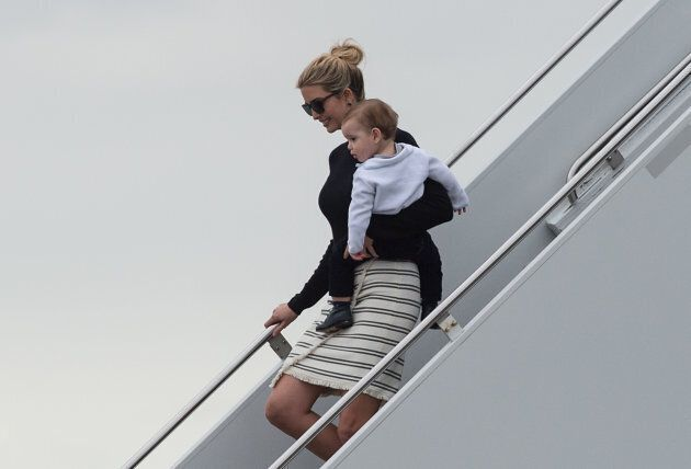 Ivanka Trump steps off Air Force One with her son Theodore upon arrival in West Palm Beach, Florida,...
