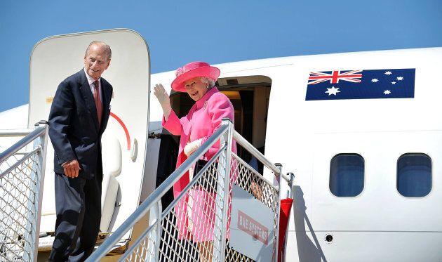 Queen Elizabeth II and Prince Philip, Duke of Edinburgh board a plane on October 26, 2011 in Melbourne,