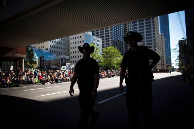 Calgary city police officers patrol during the Calgary Stampede parade in Calgary, Alta., July 4, 2014....