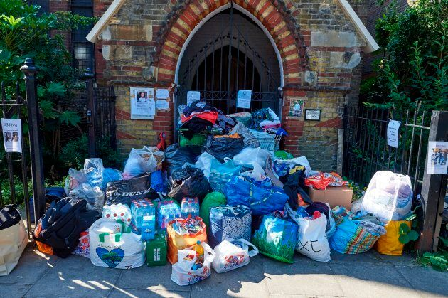 Donations left for those affected by the June 14 fire at the Grenfell Tower block are pictured outside a church in Kensington, west London, on June 17, 2017, following the June 14 fire at the residential building.