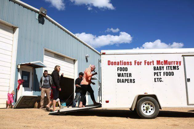 A truck with donations arrives at Wandering River, Alta. after raging forest fires forced more than 80,000 from their homes in Fort McMurray.