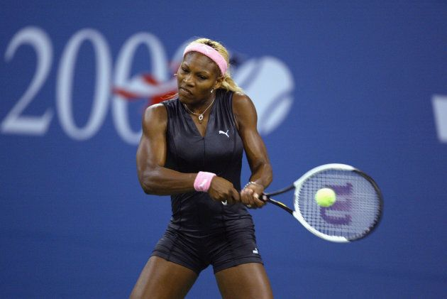 Serena Williams of the USA returns a shot to her sister Venus Williams of the USA during the women's...