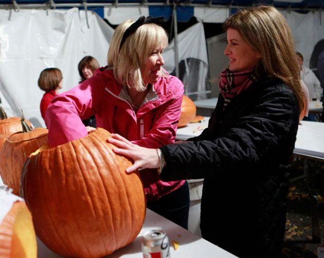 Laureen Harper hollows out a pumpkin with Rona Ambrose at 24 Sussex Drive in Ottawa October 30,