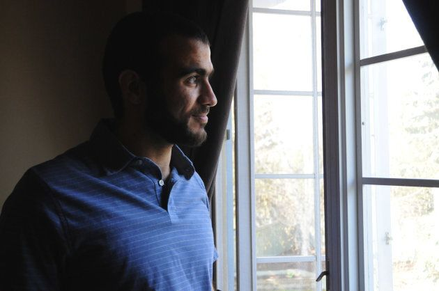 Omar Khadr looks out the window of his home on May 9, 2015, two days after being freed after having spent...