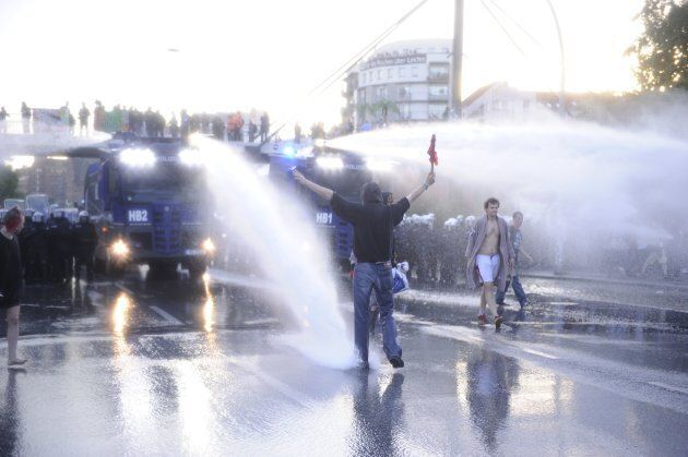 Riot police use water cannon during the 'Welcome to Hell' rally against the G20 summit in Hamburg, northern...