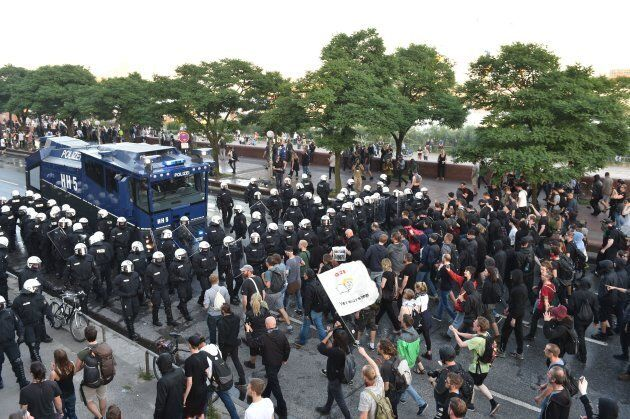 Riot Police use a water cannon during the 'Welcome to Hell' rally against the G20 summit in Hamburg,...