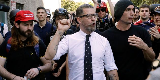 In this April 27, 2017 file photo, Gavin McInnes, centre, founder of the far-right group Proud Boys, is surrounded by supporters after speaking at a rally in Berkeley, Calif.