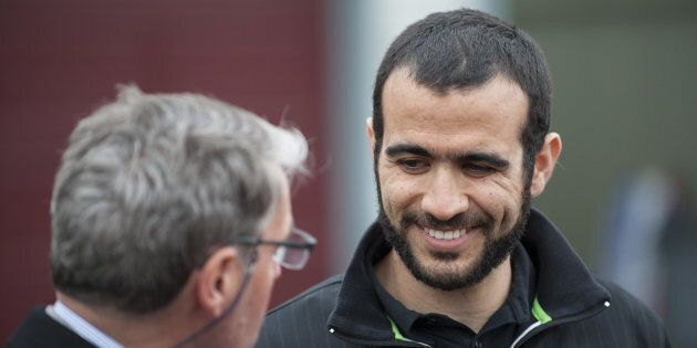 Omar Khadr smiles at his lawyer Dennis Edney, left, as he answers questions during a news conference...