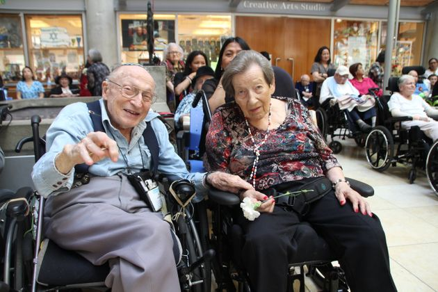 Baycrest resident and Holocaust survivor Rosa Weisberg (right) sits with husband Sam Weisberg while enjoying...