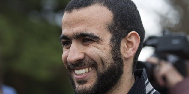 Omar Khadr smiles as he answers questions during a news conference after being released on bail in Edmonton,...