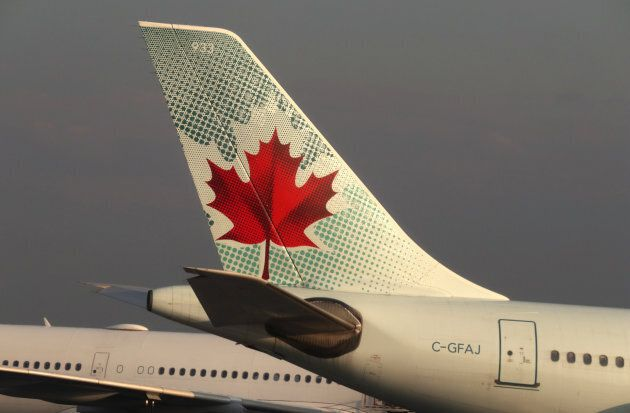 The tail end of an Air Canada airplane is seen at Toronto Pearson International Airport in Toronto, Canada on May 13, 2017.