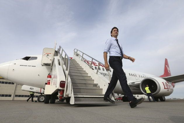 Liberal leader Justin Trudeau steps off his campaign plane in Calgary, Alta. on Oct. 18,