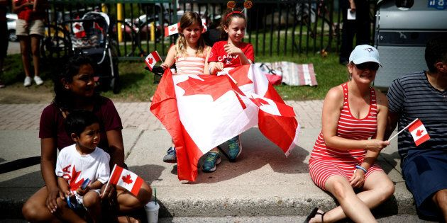 People watch the East York Toronto Canada Day parade, as the country marks its 150th anniversary