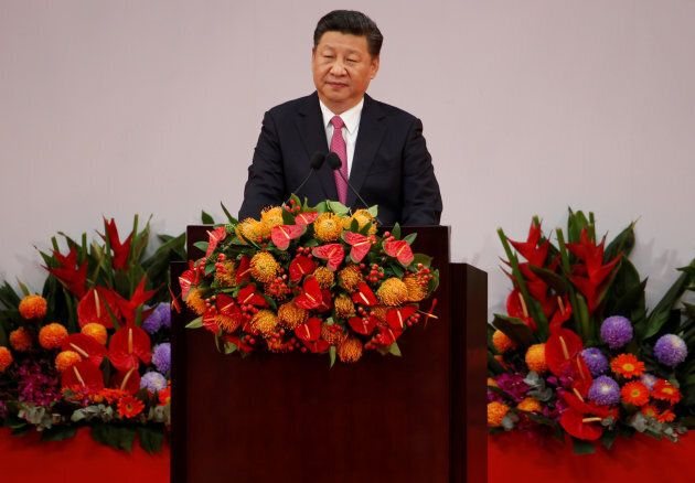 Chinese President Xi Jinping delivers his speech during the 20th anniversary of the city's handover from...