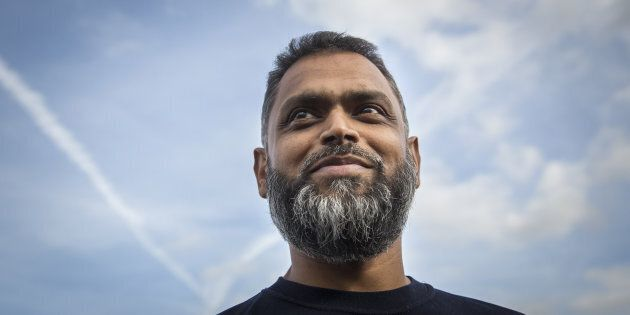 Moazzam Begg speaks to journalists after being released from Belmarsh Prison on Oct. 1, 2014 in London,