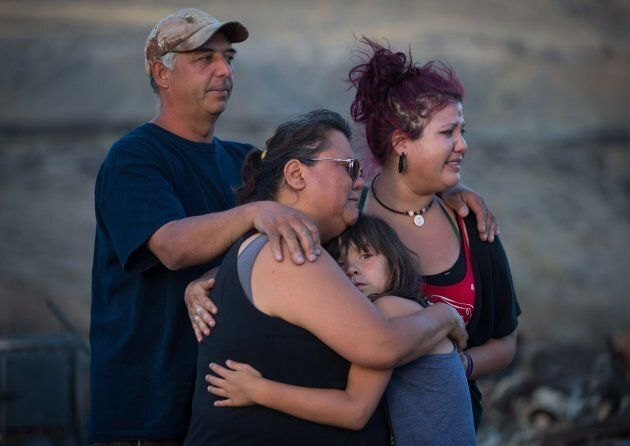 Randy Thorne, his wife Angie, their daughter Kelsey, and granddaughter Nevaeh, 8, comfort one another...