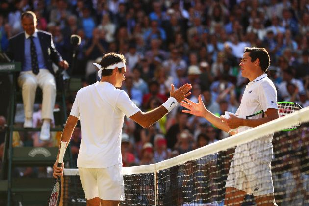 Roger Federer (left) and Milos Raonic shake hands after their match at Wimbledon. (Photo by Michael Steele/Getty