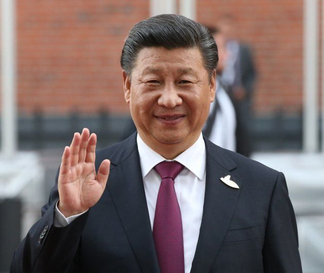 Chinese President Xi Jinping waves arriving for dinner during the G20 Summit on July,7,2017 in Hamburg,