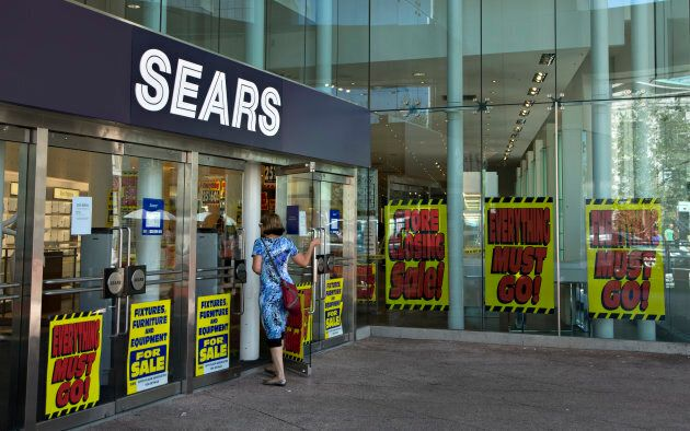 A customer enters the soon-to-be-closed Sears store in downtown Vancouver, Sept. 13,