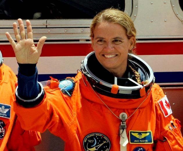 STS-127 Mission Specialist Julie Payette waves before boarding the astronaut van for a trip to launch...