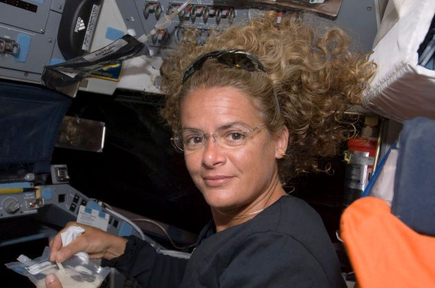 Canadian Space Agency astronaut Julie Payette, STS-127 mission specialist, poses on flight deck of the...