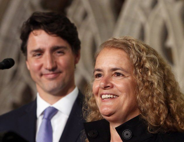 Prime Minister Justin Trudeau looks on as former astronaut, and Governor General designate, Julie Payette,talks...