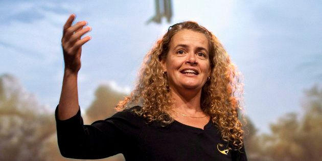 Canadian astronaut Julie Payette describes her mission to the International Space Station with a photograph...