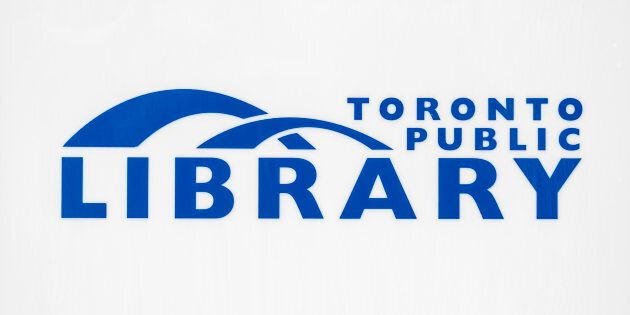 Toronto Public Library logo on a wall.