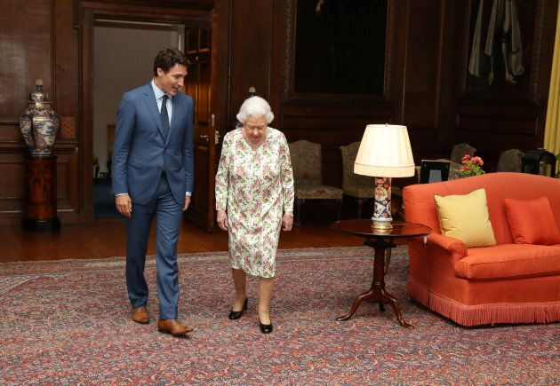 Queen Elizabeth II greets Prime Minister Justin Trudeau during an audience at the Palace of Holyroodhouse...